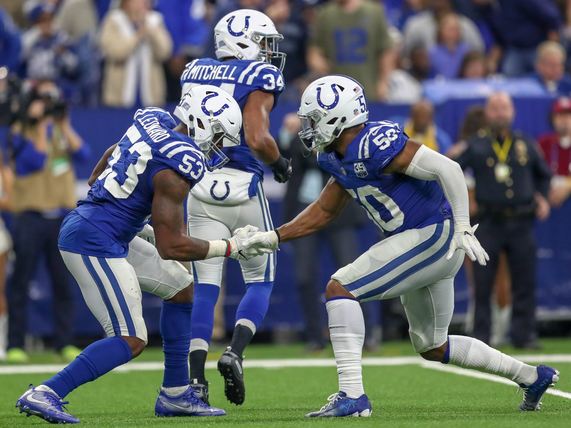 Colts outside linebackers Darius Leonard (53) and Anthony Walker (50) celebrate a Leonard sack against Tennessee Titans quarterback Marcus Mariota (8) at Lucas Oil Stadium in Indianapolis, on Sunday, Nov. 18, 2018.