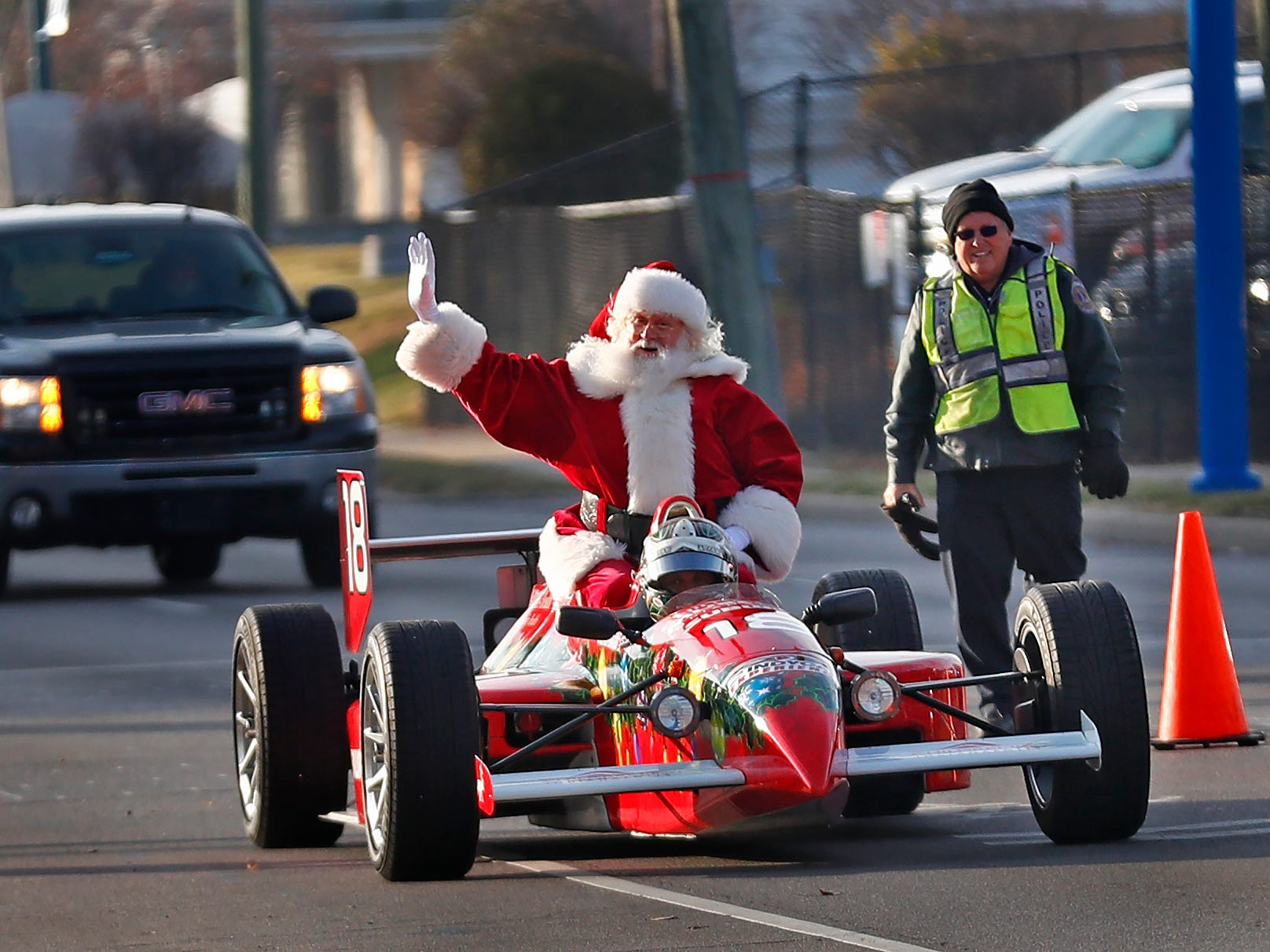 Santa arrives at the Children's Museum of Indianapolis in an IndyCar driven by racer Ed Carpenter, Friday, Nov. 23, 2018.