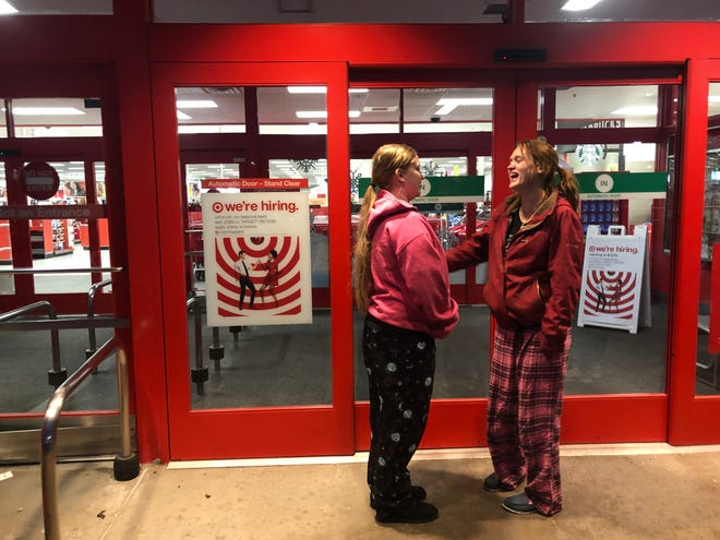 Sisters Jamie and Sierra Price stand first in line at Target Friday morning, Nov. 23, to take advantage of Black Friday deals.