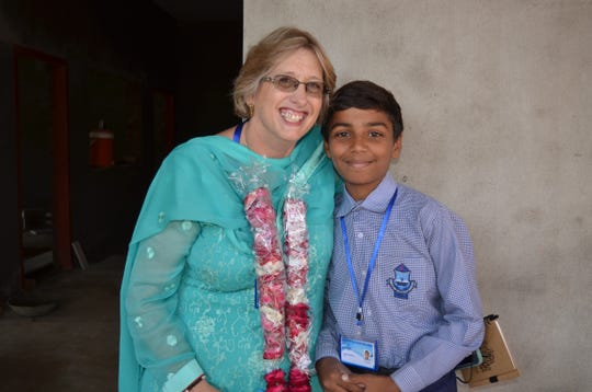 Amy Nicholson poses for a picture with a student at the Pasrur Christian Boys School. The Nicholsons donated $100,000 to the private school in Pakistan, making education possible for more students.