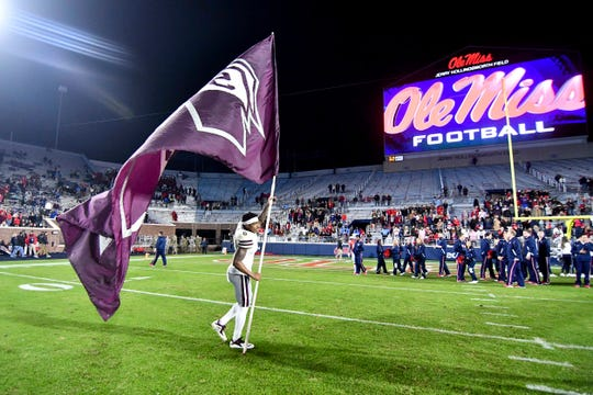 Nov 22, 2018; Oxford, MS, USA; Mississippi State Bulldogs cornerback Maurice Smitherman (8) plants a  flag after the game against the Ole Miss Rebels at Vaught-Hemingway Stadium. Mandatory Credit: Matt Bush-USA TODAY Sports