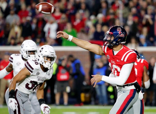 Mississippi quarterback Jordan Ta'amu (10) throws a pass against Mississippi State during the first half of an NCAA college football game in Oxford, Miss., Thursday, Nov. 22, 2018.