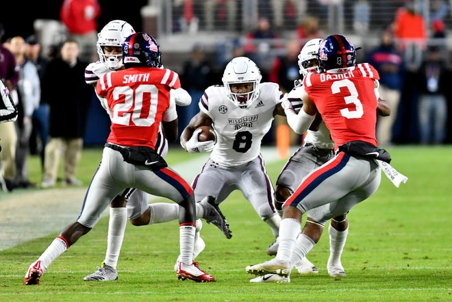 Nov 22, 2018; Oxford, MS, USA; Mississippi State Bulldogs running back Kylin Hill (8) runs the ball against the Ole Miss Rebels during the first quarter at Vaught-Hemingway Stadium. Mandatory Credit: Matt Bush-USA TODAY Sports