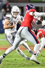 Nov 22, 2018; Oxford, MS, USA; Mississippi State Bulldogs quarterback Nick Fitzgerald (7) runs the ball against the Ole Miss Rebels during the first quarter at Vaught-Hemingway Stadium. Mandatory Credit: Matt Bush-USA TODAY Sports