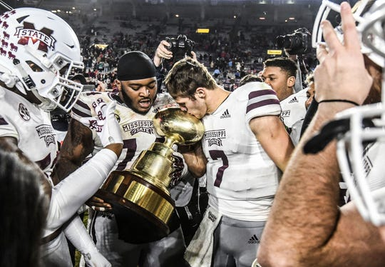 Mississippi State offensive lineman Elgton Jenkins (74) and quarterback Nick Fitzgerald (7) kiss the Golden Egg following a win over Mississippi in Oxford, Miss., Thursday, Nov. 22, 2018.