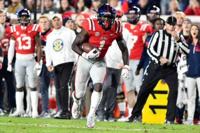 Nov 22, 2018; Oxford, MS, USA; Ole Miss Rebels wide receiver A.J. Brown (1) runs the ball against the Mississippi State Bulldogs during the second quarter  at Vaught-Hemingway Stadium. Mandatory Credit: Matt Bush-USA TODAY Sports