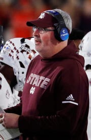 Mississippi State coach Joe Moorhead watches his players during the second half of an NCAA college football game against Mississippi in Oxford, Miss., Thursday, Nov. 22, 2018. Mississippi State won 35-3.