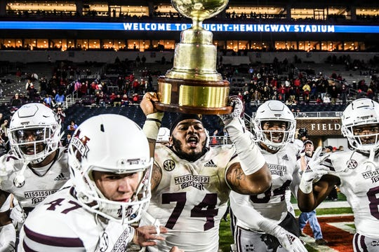 Mississippi State offensive lineman Elgton Jenkins (74) holds the Golden Egg following the team's win over Mississippi in an NCAA college football game Thursday, Nov. 22, 2018, in Oxford, Miss. Mississippi State won 35-3.