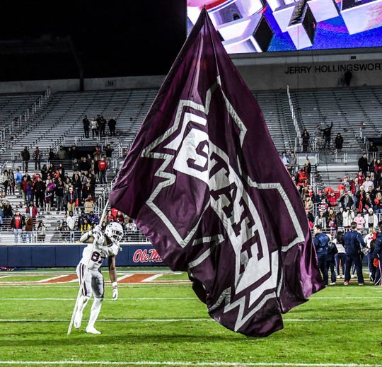 Mississippi State tight end Farrod Green (82) plants a flag at Vaught-Hemingway Stadium following a win over Mississippi in Oxford, Miss., Thursday, Nov. 22, 2018.