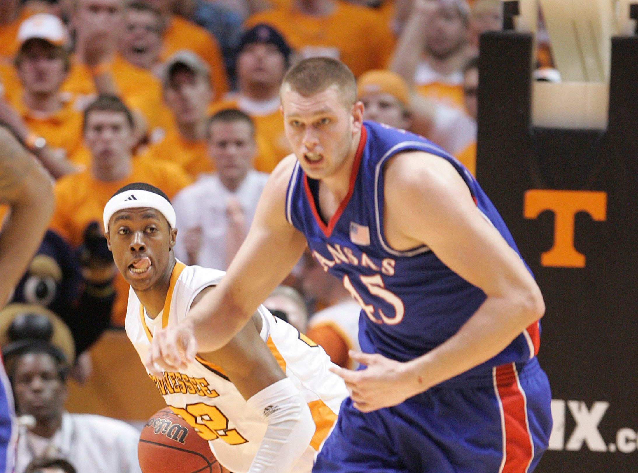 Tennessee's Scotty Hopson (32) rebounds ball against Kansas' Cole Aldrich (45) during the first half of an NCAA college basketball game Sunday, Jan. 10, 2010, in Knoxville, Tenn.