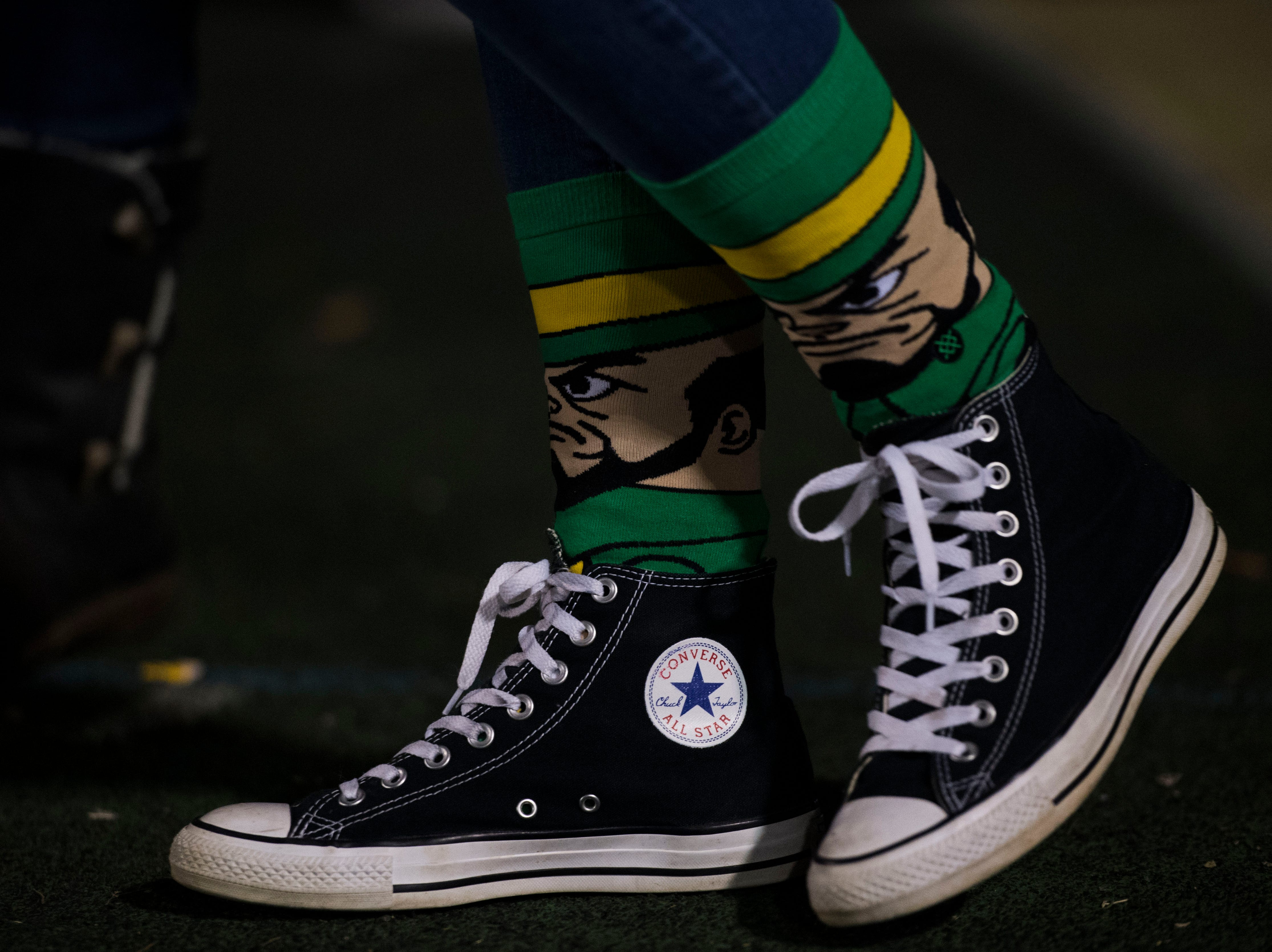 Erin Nicely wears spirited socks before a game between Catholic and Central at Catholic Friday, Nov. 23, 2018.