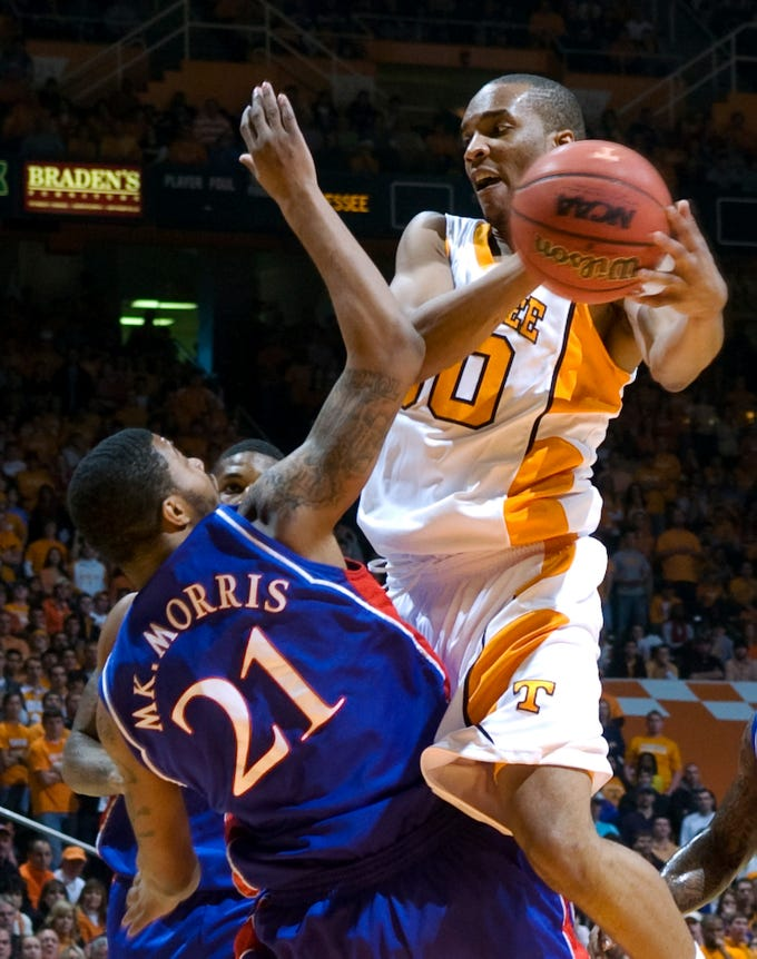 Tennessee's J.P. Prince, right, runs into Kansas' Markieff Morris (21) while driving towards the basket in an NCAA college basketball game at Thompson-Boling Arena, Sunday, Jan. 10, 2010, in Knoxville, Tenn. Tennessee defeated Kansas 76-68.
