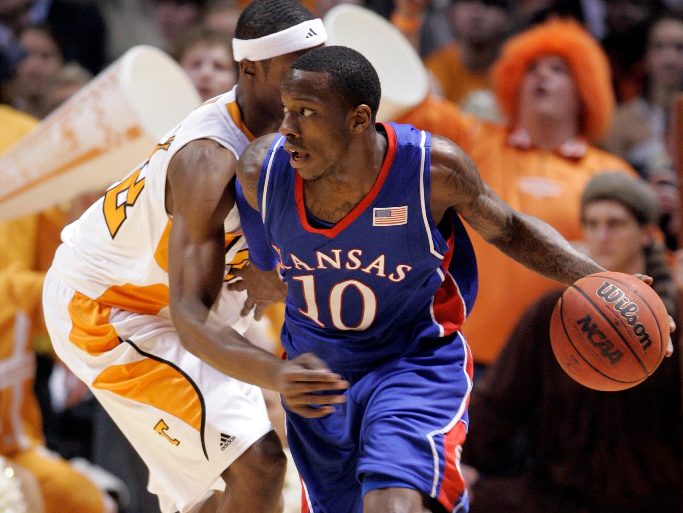 Kansas' Tyshawn Taylor (10) drives to the basket against Tennessee's Scotty Hopson (32) during the second half of an NCAA college basketball game Sunday, Jan. 10, 2010, in Knoxville, Tenn. Tennessee won 76-68.