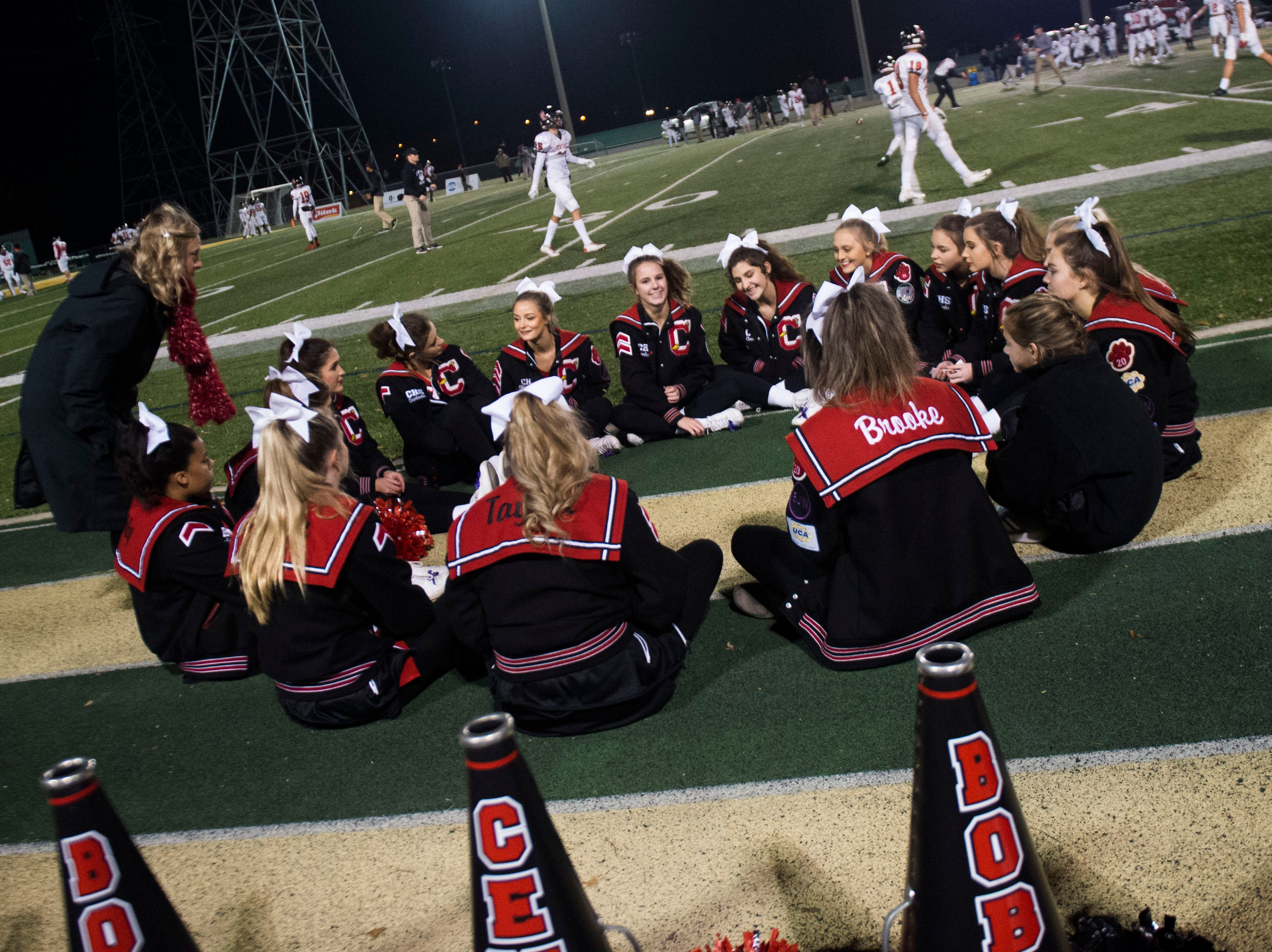 Central cheerleaders gather before a game between Catholic and Central at Catholic Friday, Nov. 23, 2018.