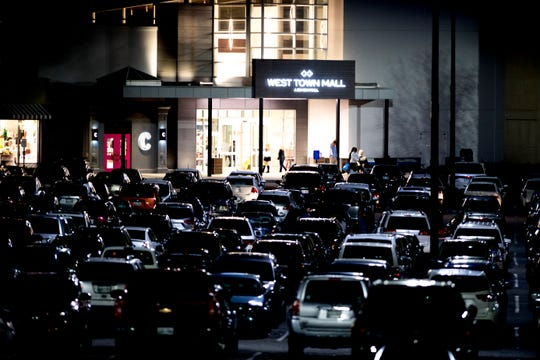 The West Town Mall parking lot is filled during Black Friday shopping in West Knoxville, Tennessee on Thursday, November 22, 2018.