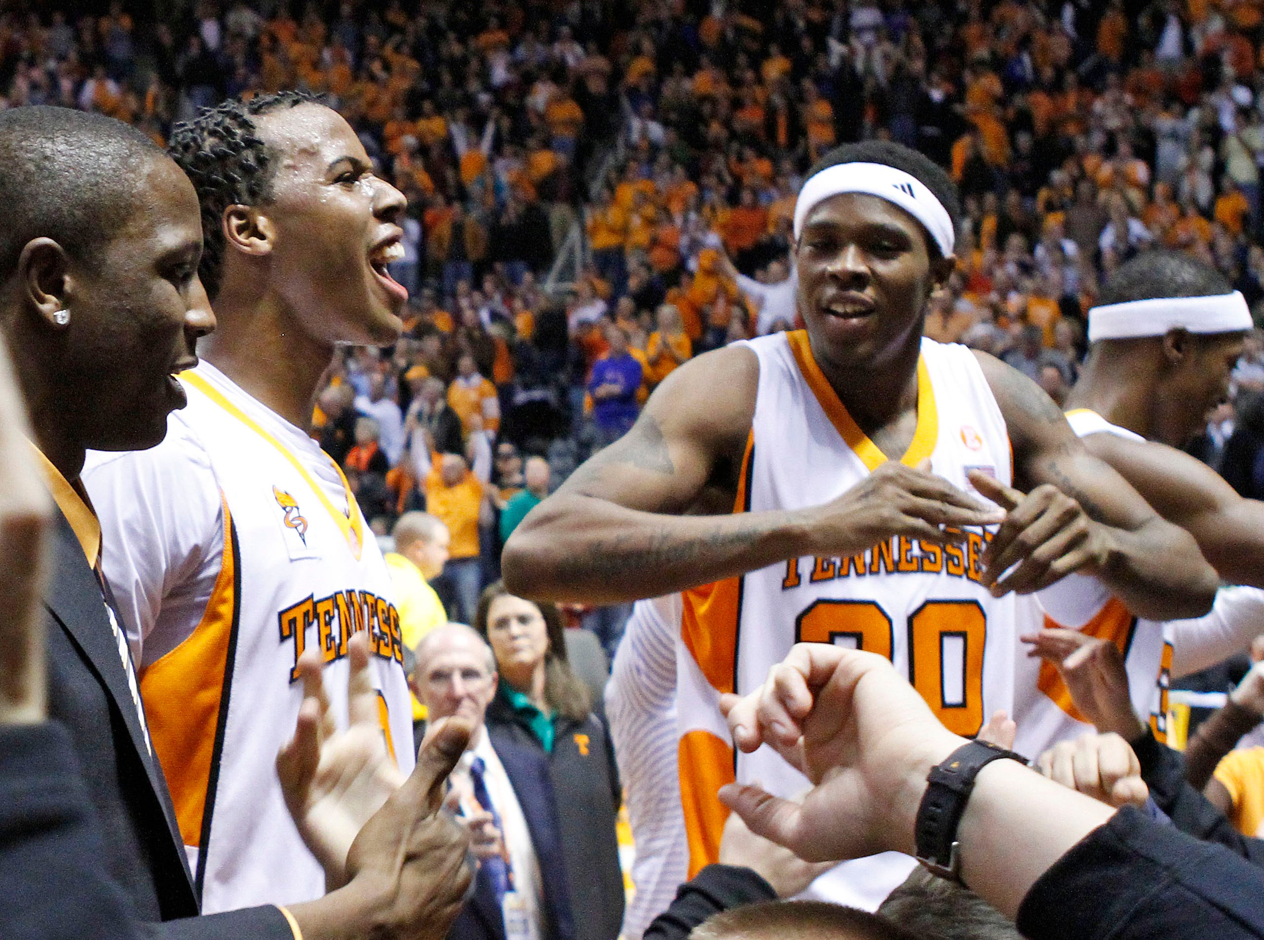 Tennessee's Scotty Hopson, right, and Renaldo Woolridge (0) celebrate with fans after Tennessee defeated Kansas 76-68 in an NCAA college basketball game Sunday, Jan. 10, 2010, in Knoxville, Tenn.