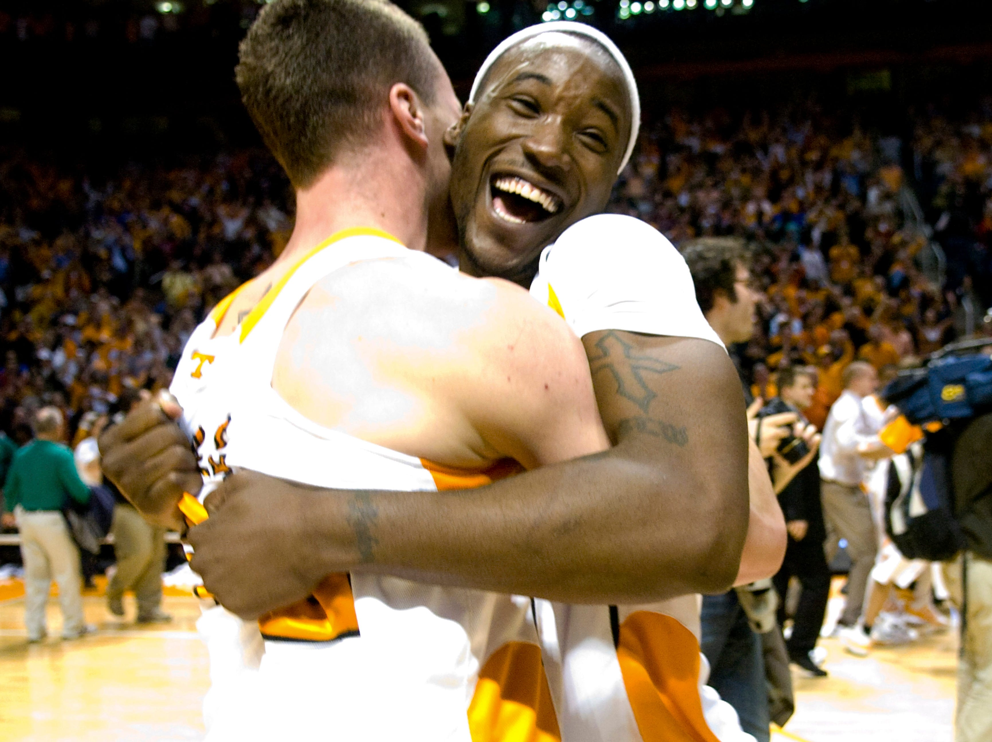 Tennessee's Wayne Chism celebrates with teammate Steven Pearl after Tennessee defeated Kansas 76-68 in an NCAA college basketball game at Thompson-Boling Arena, Sunday, Jan. 10, 2010, in Knoxville, Tenn.