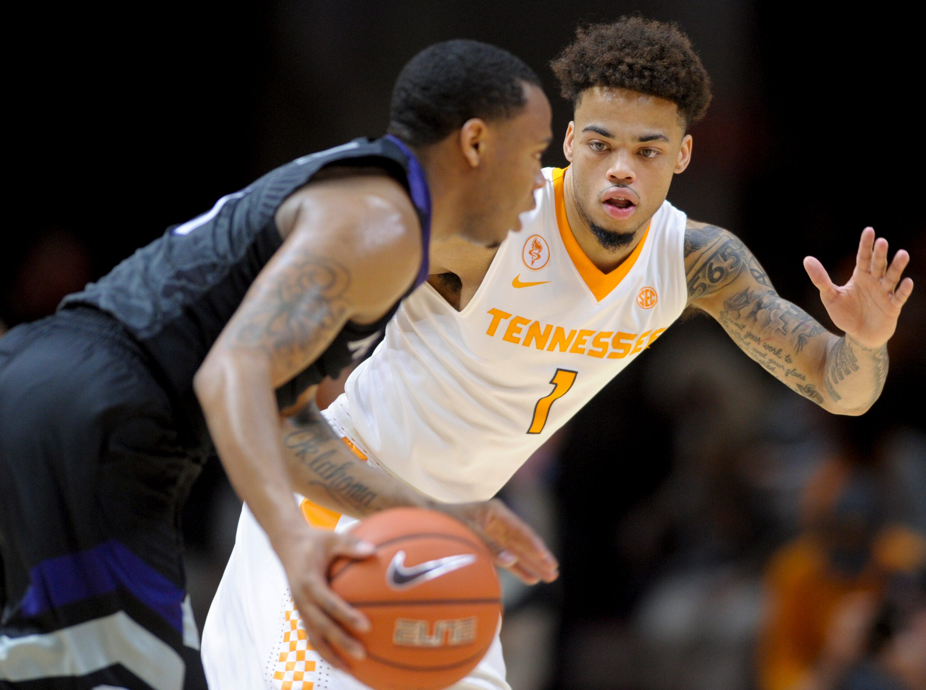 TennesseeÕs LamontŽ Turner (1) defends against Kansas StateÕs Carlbe Ervin II (1) during an NCAA SEC-Big 12 basketball game between Tennessee and Kansas State at Thompson-Boling Arena in Knoxville, Tennessee on Saturday, January 28, 2017.