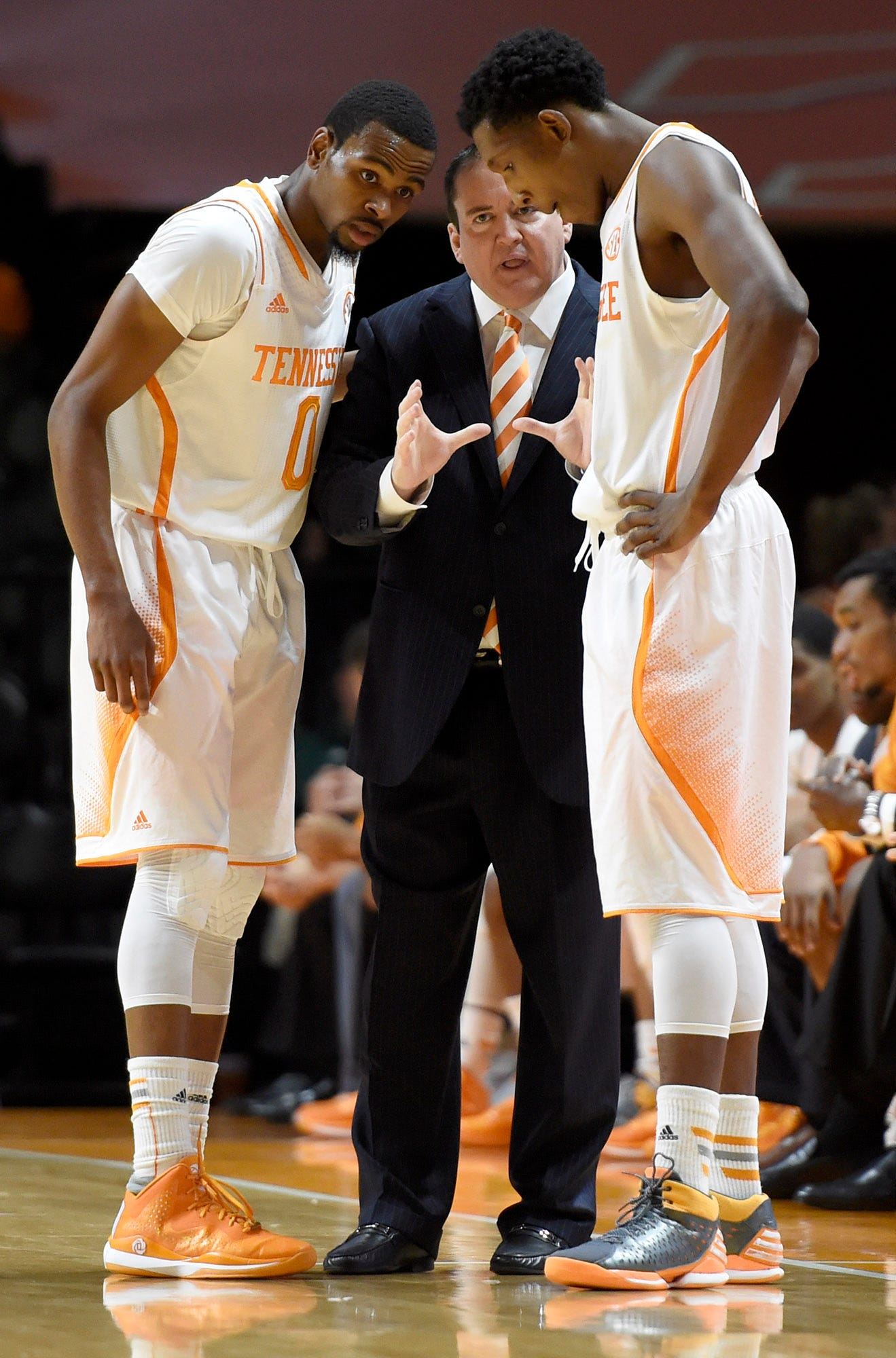 Donnie Tyndall spent one year as Tennessee's basketball coach in 2014-15. The Vols finished 16-16 under his watch, with help from standout guards Kevin Punter, left, and Josh Richardson.