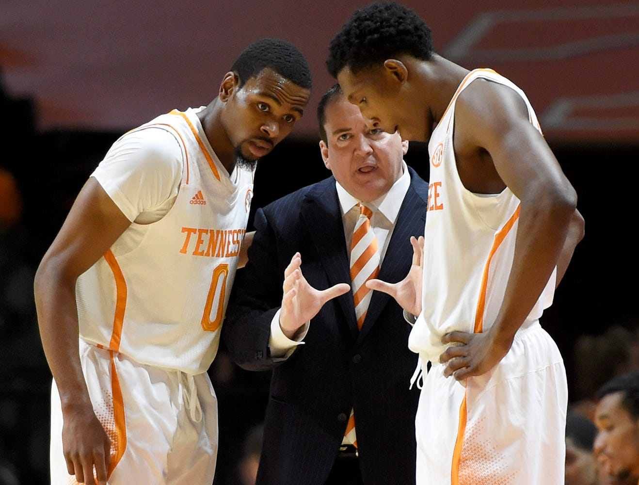 Tennessee coach Donnie Tyndall talks with Tennessee guard Kevin Punter (0) and Tennessee guard Josh Richardson (1) during their NCAA college basketball game against Kansas State at Thompson-Boling Arena in Knoxville, Tenn., Saturday, Dec. 6, 2014.  Tennessee won 65-64.
