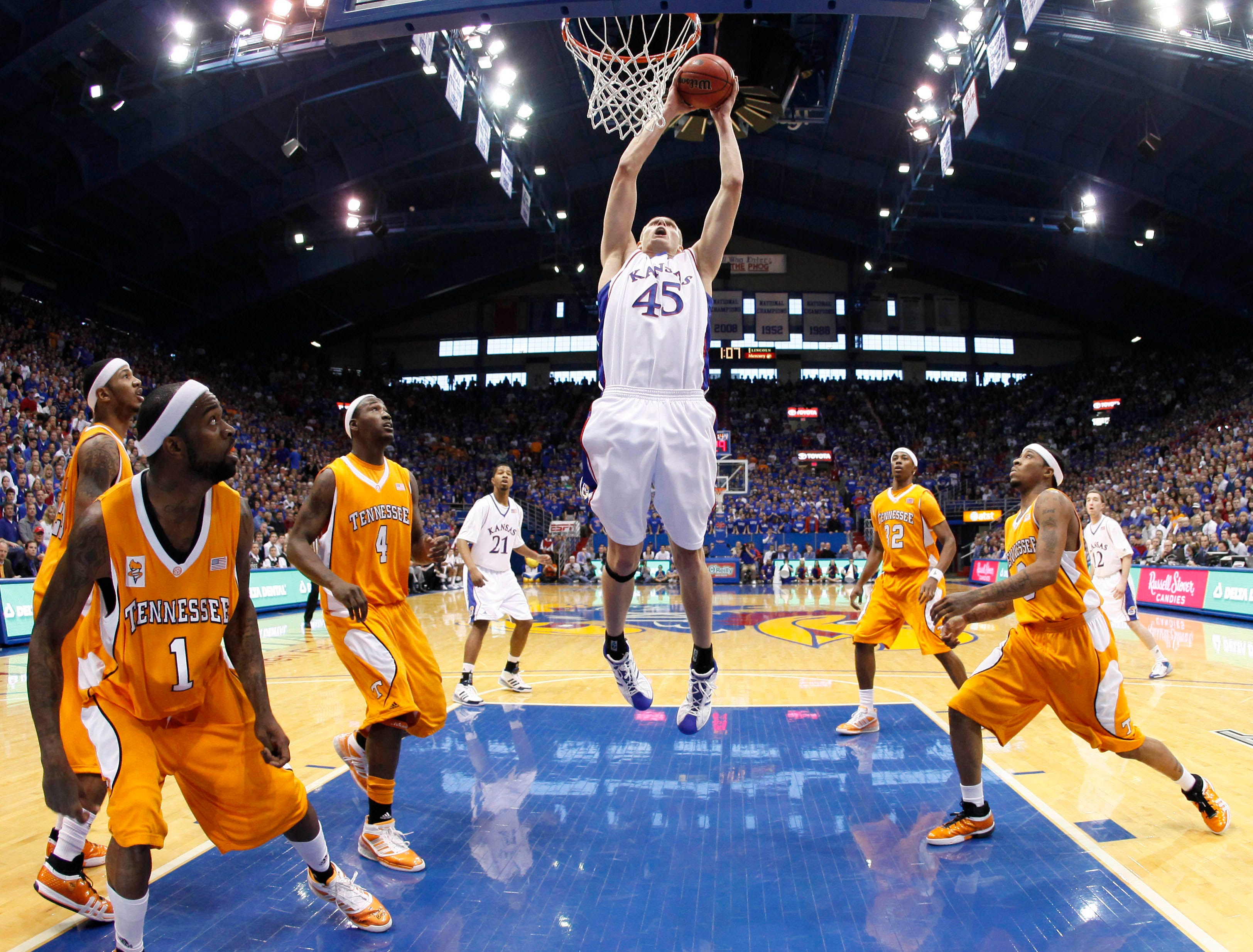 Kansas' Cole Aldrich (45) gets past a group of Tennessee defenders to put up a shot during the first half of an NCAA college men's basketball game Saturday, Jan. 3, 2009 in Lawrence, Kan.