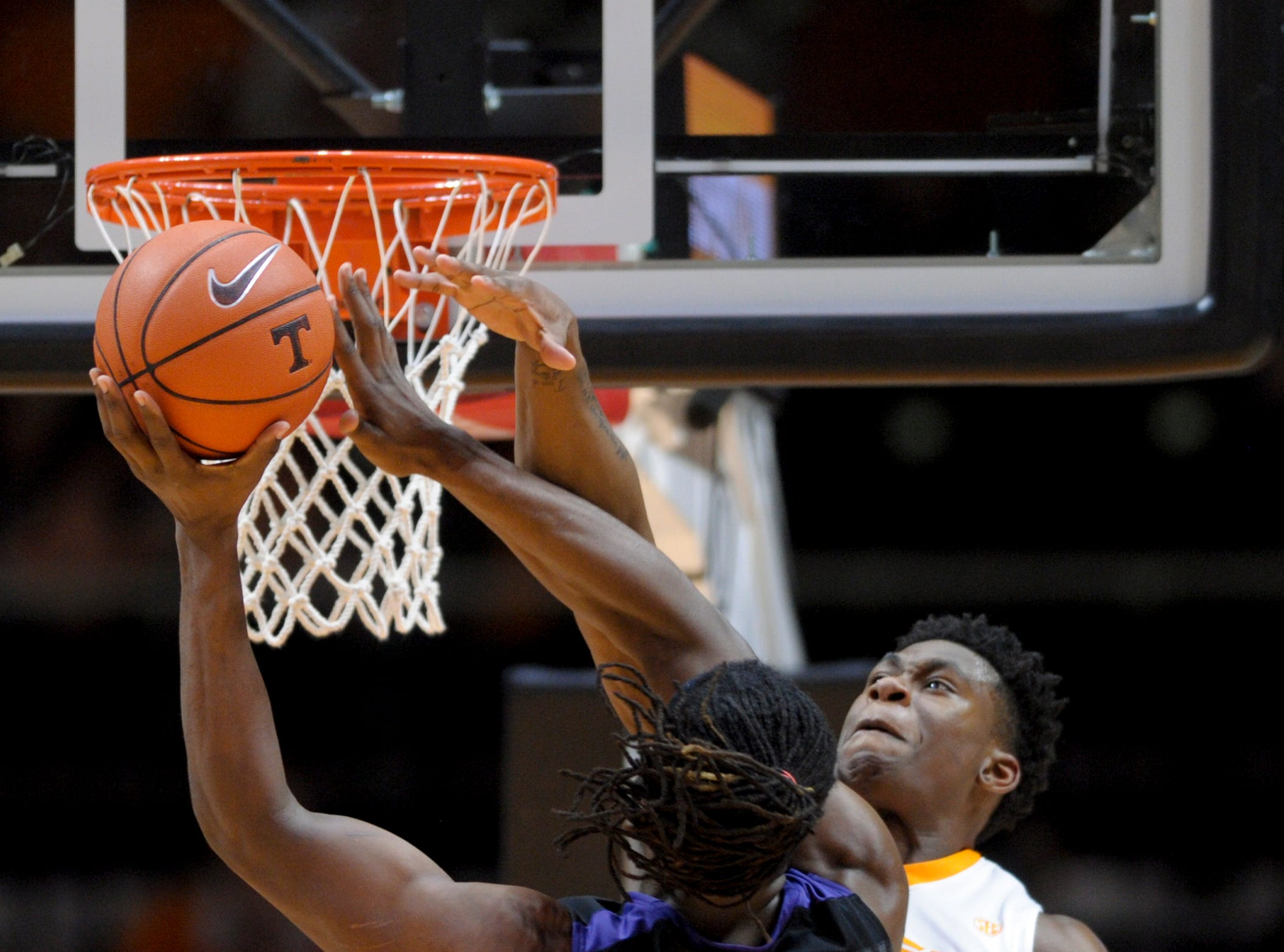 Tennessee‰Ûªs Admiral Schofield (5) blocks a shot by Kansas State‰Ûªs D.J. Johnson (4) during an NCAA SEC-Big 12 basketball game between Tennessee and Kansas State at Thompson-Boling Arena in Knoxville, Tennessee on Saturday, January 28, 2017.