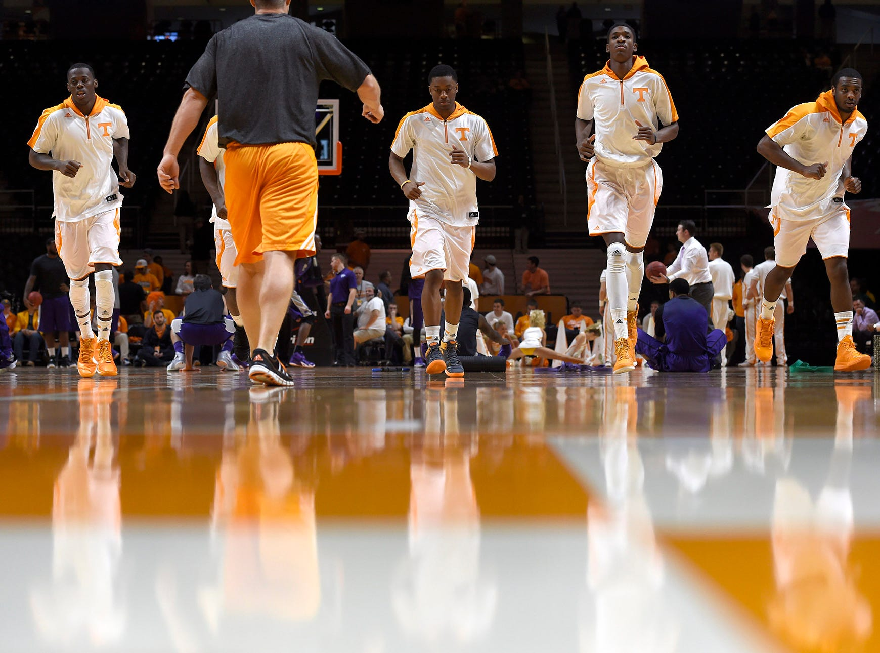 Tennessee players warm up before their NCAA college basketball game against Kansas State at Thompson-Boling Arena in Knoxville, Tenn., Saturday, Dec. 6, 2014.