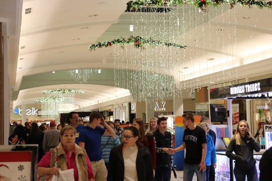 Some shoppers head out to malls and retailers to view holiday display, browse for gifts and get into the holiday spirit.