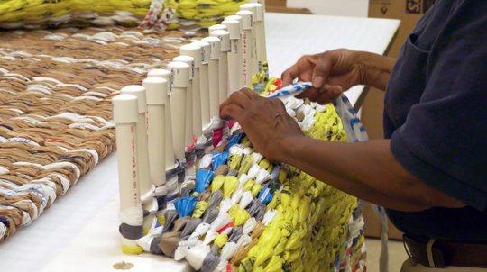 Shelia Johnson, of Oak Valley Baptist Church in Oak Ridge, makes mats for Knoxville's homeless from recycled plastic grocery bags.