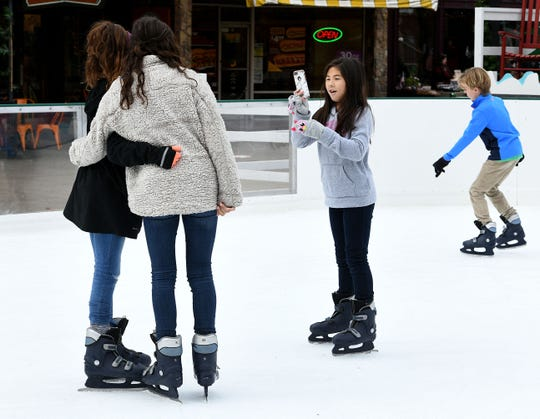 Families and friends enjoy skating in the heart of downtown Knoxville in Market Square.
