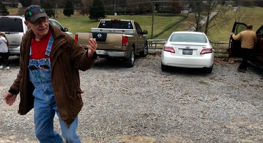 Leo Collins, owner of Bluebird Christmas Tree Farm, directs traffic as customers arrive to pick out their trees the day after Thanksgiving. Collins started growing trees 36 years ago and has been selling them for 30 years.