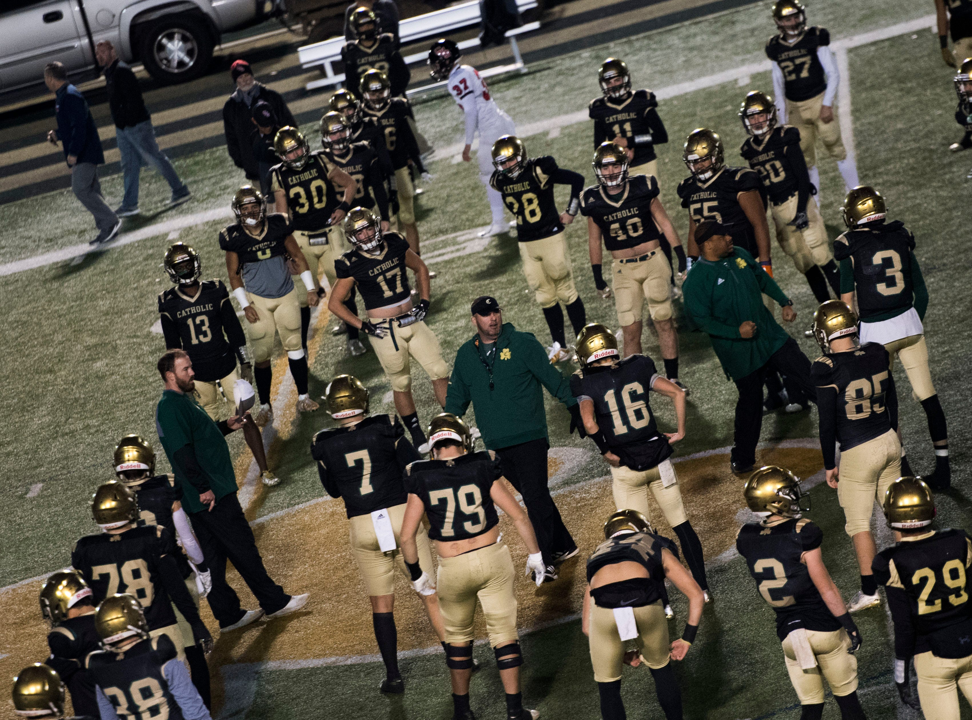 Catholic players warm up on the field before a TSSAA high school football semifinal game between Catholic and Central at Catholic Friday, Nov. 23, 2018.