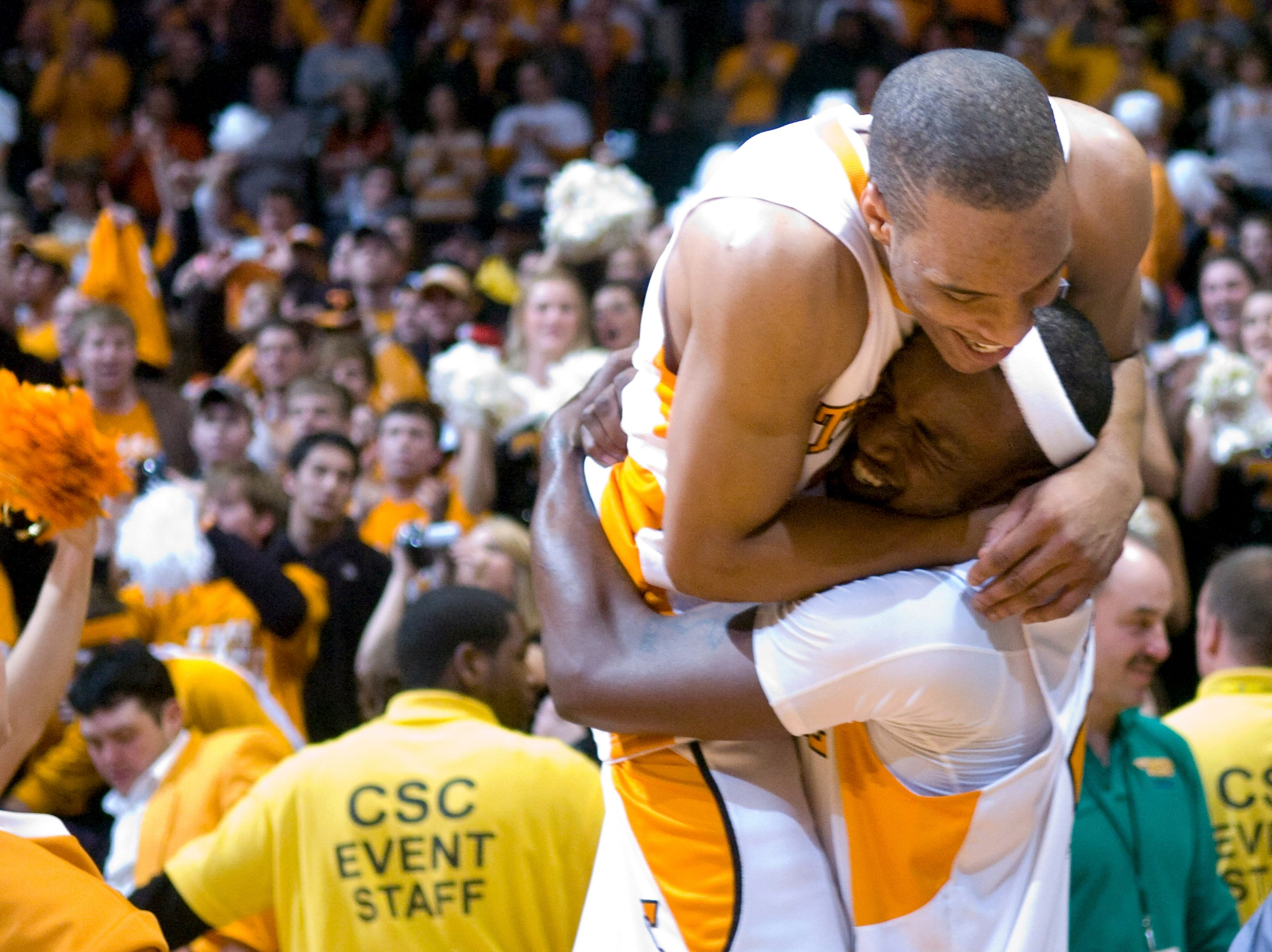 Tennessee's J.P. Prince, top, and Wayne Chism celebrate Tennessee's 76-68 win over Kansas in an NCAA college basketball game at Thompson-Boling Arena on Sunday, Jan. 10, 2010, in Knoxville, Tenn.