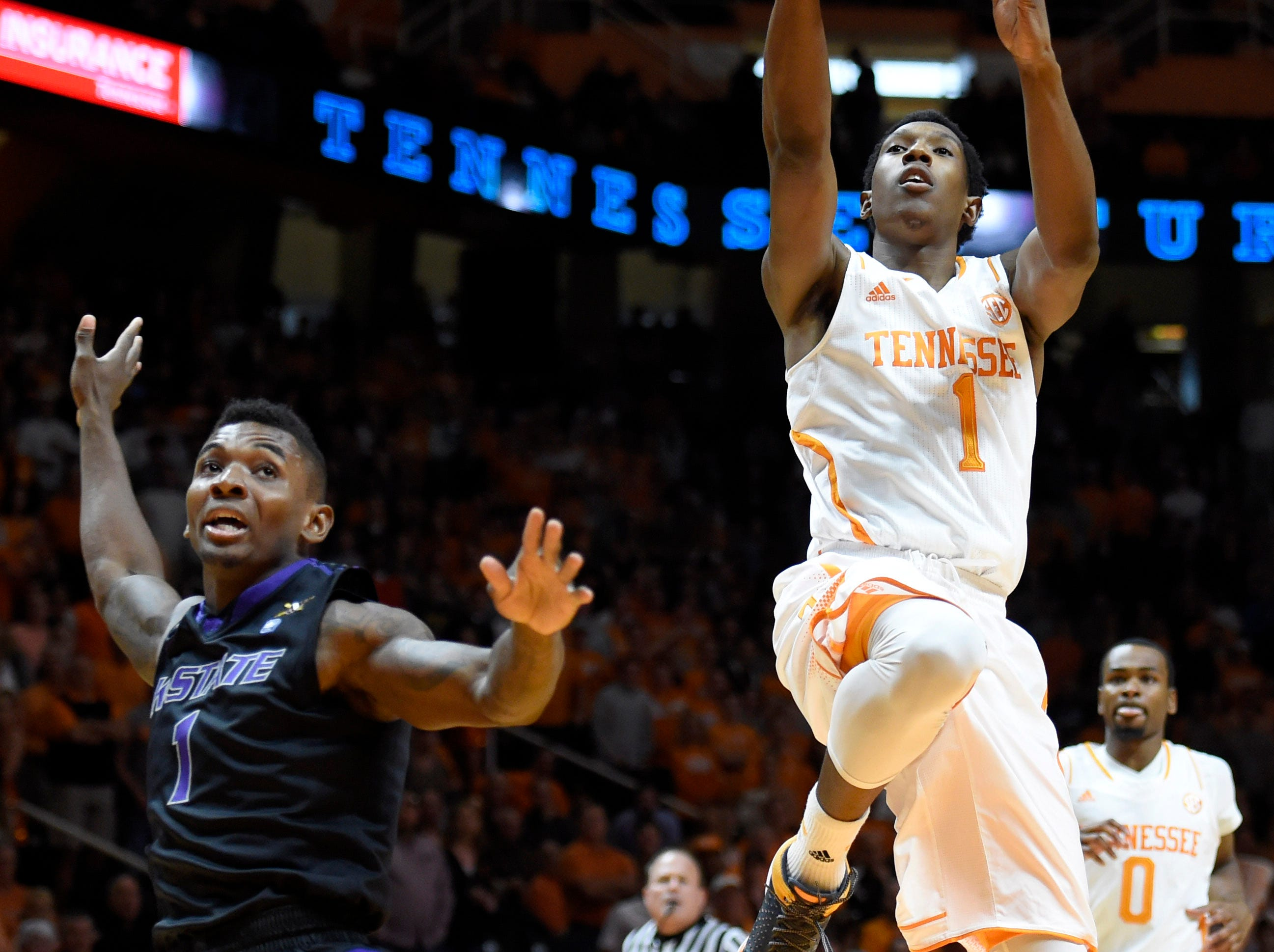 Tennessee guard Josh Richardson (1) drives to the basket past Kansas State guard Jevon Thomas (1) during their NCAA college basketball game at Thompson-Boling Arena in Knoxville, Tenn., Saturday, Dec. 6, 2014.