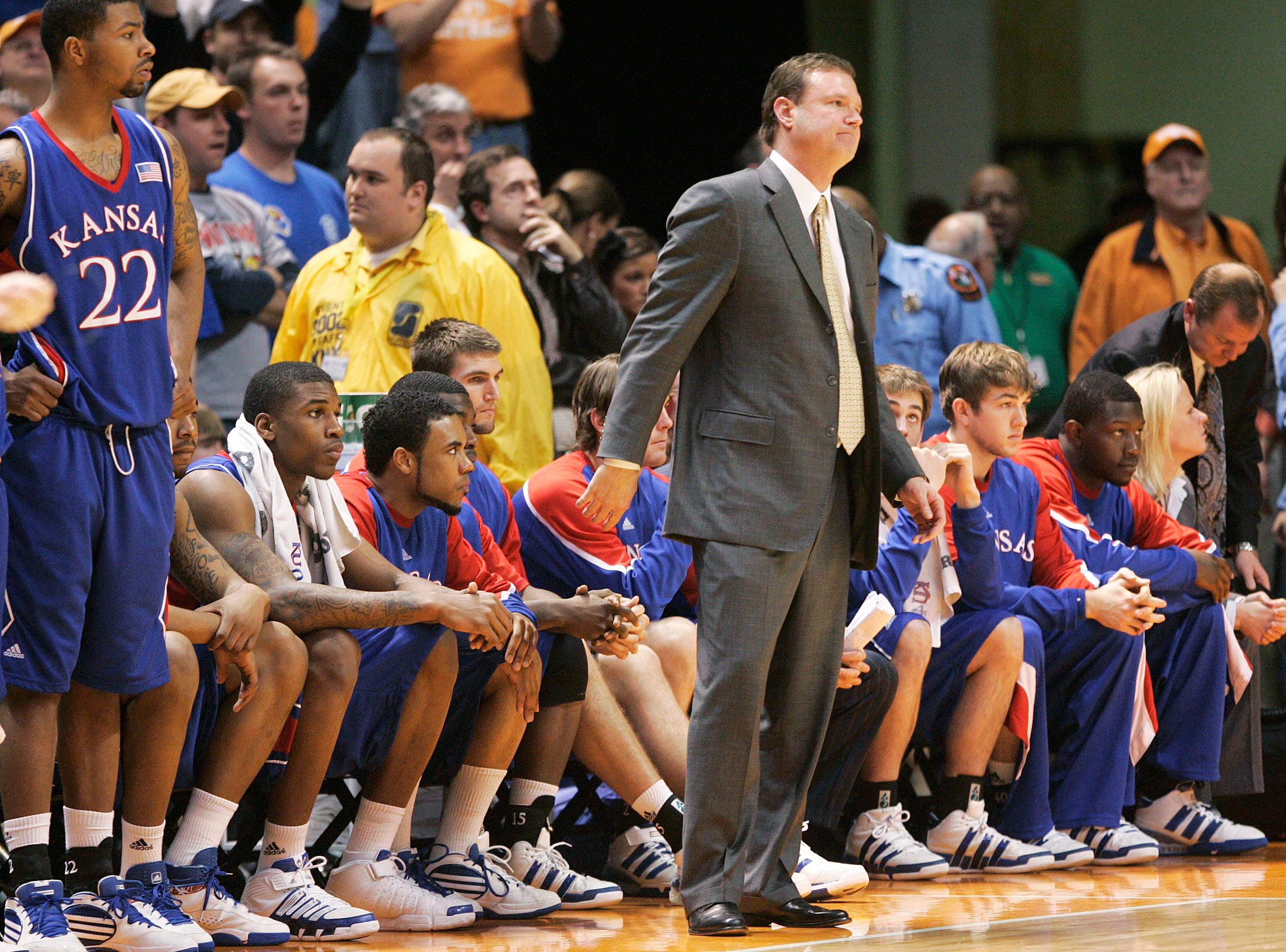 Kansas head coach Bill Self and his team look on against Tennessee in the second half of an NCAA college basketball game Sunday, Jan. 10, 2010, in Knoxville, Tenn. Tennessee won 76-68.