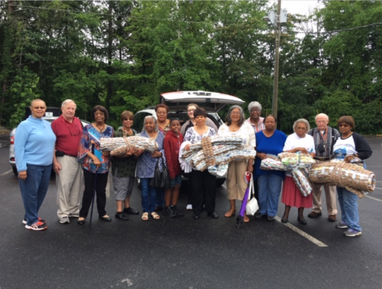 Oak Valley Baptist Church seniors gather at Knoxville Area Rescue Ministries to drop off their handmade sleeping mats — each crocheted, knitted or woven from recycled plastic grocery bags.