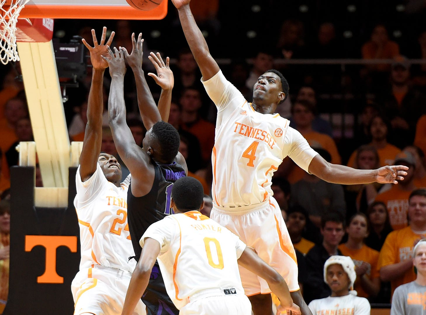 Tennessee forward Armani Moore (4) blocks a shot by Kansas State forward Malek Harris (10) during their NCAA college basketball game at Thompson-Boling Arena in Knoxville, Tenn., Saturday, Dec. 6, 2014.  Tennessee won 65-64.