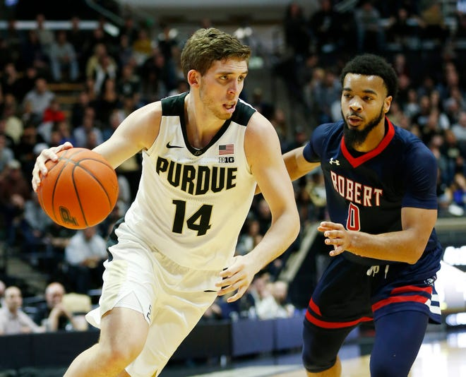 Ryan Cline of Purdue gets a step on Josh Williams of Robert Morris Friday, November 23, 2018, at Mackey Arena. Purdue defeated Robert Morris 84-46.