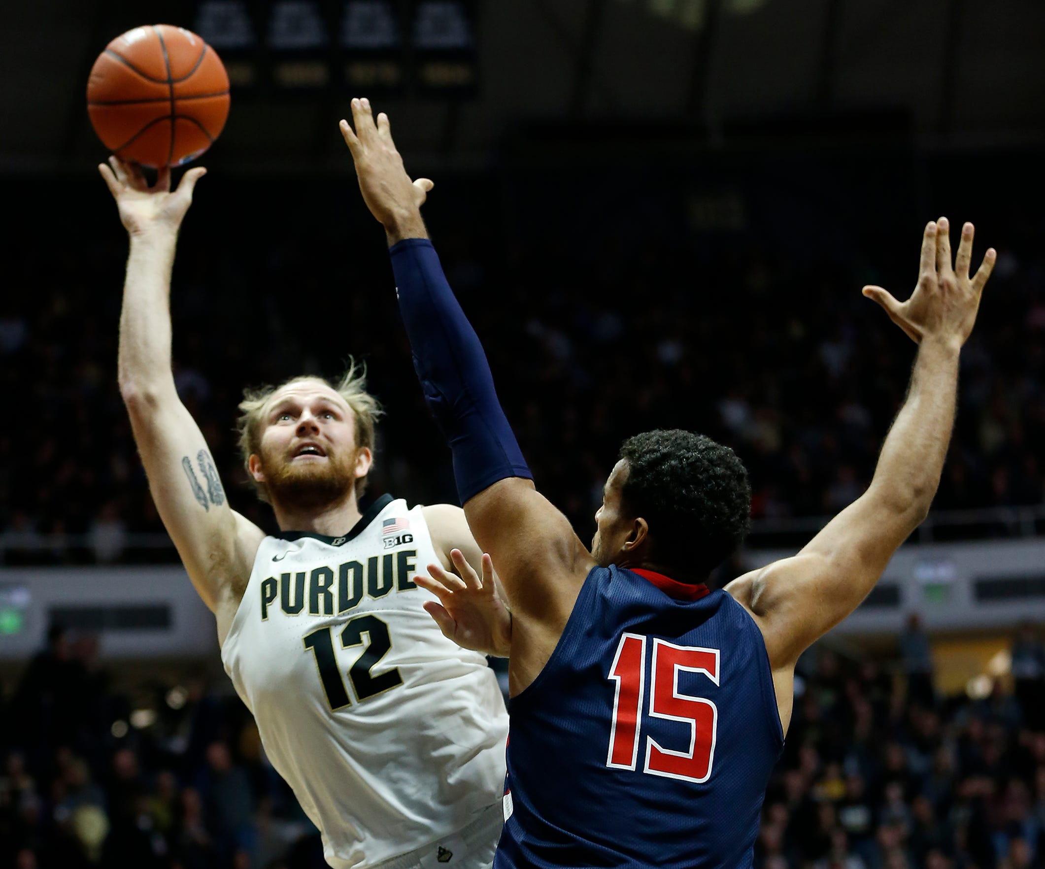 Evan Boudreaux of Purdue with a shot over Yannis Mendy of Robert Morris Friday, November 23, 2018, at Mackey Arena. Purdue defeated Robert Morris 84-46.