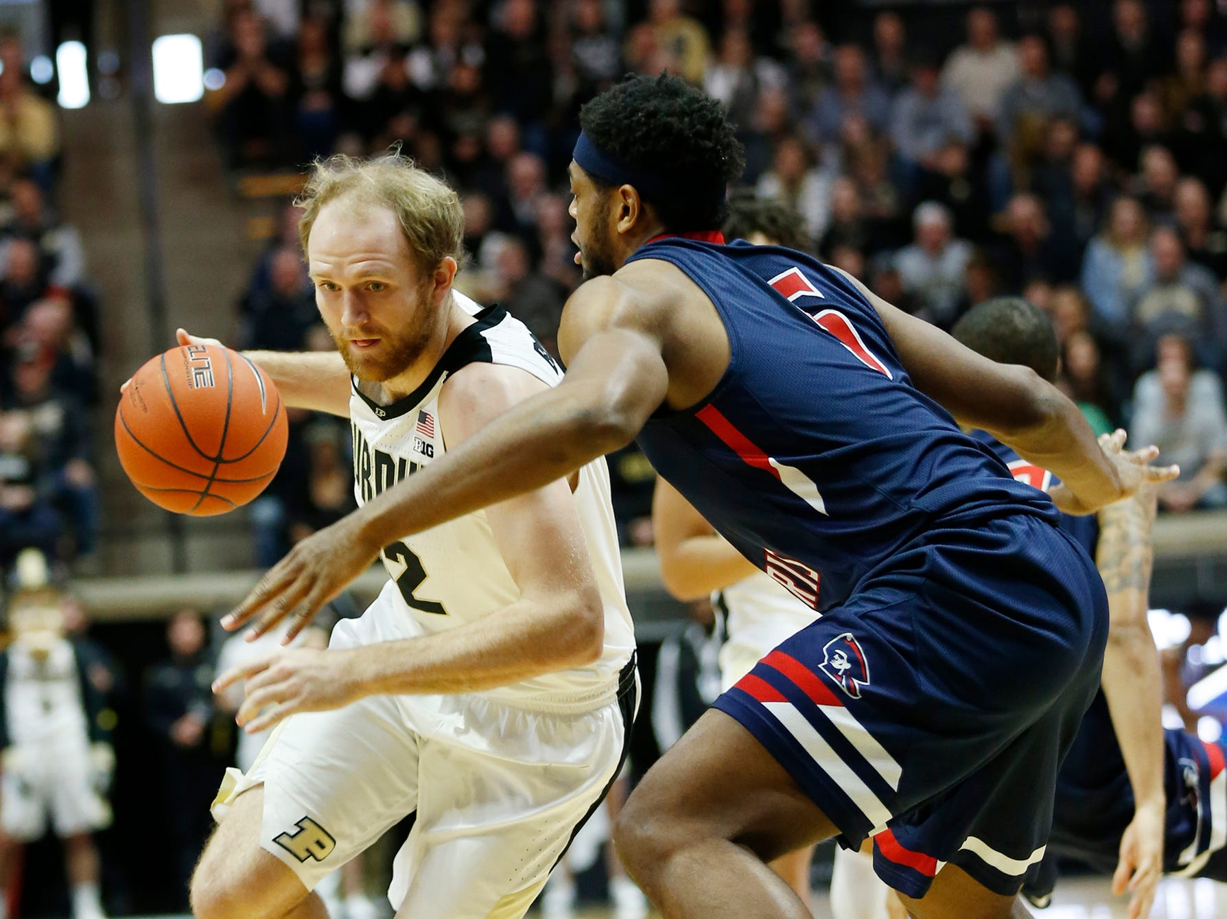 Evan Boudreaux of Purdue with a drive against Malik Petteway of Robert Morris Friday, November 23, 2018, at Mackey Arena. Purdue defeated Robert Morris 84-46.