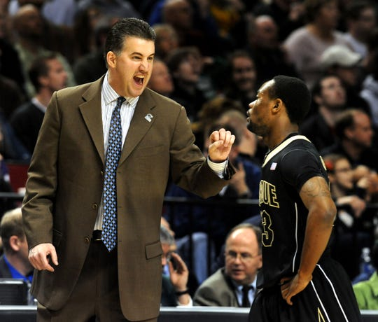 Mar 21,2009; Portland, OR, USA; Purdue Boilermakers head coach Matt Painter has some words with guard Lewis Jackson (23) in the second half of the second round game against the Washington Huskies of the 2009 NCAA mens basketball tournament at the Rose Garden. Purdue won the game 76-74.  Mandatory Credit: Steve Dykes-USA TODAY Sports