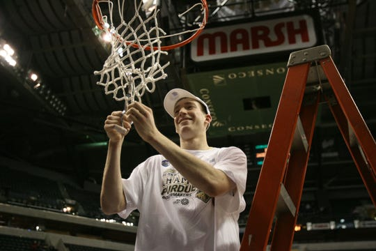 Mar 15, 2009; Indianapolis, IN, USA;  Purdue Boilermakers forward (4) Robbie Hummel cuts down the net after defeating Ohio State to win the Big Ten Basketball Tournament at Conseco Fieldhouse. Purdue defeated Ohio State 65-61. Mandatory Credit: Brian Spurlock-USA TODAY Sports
