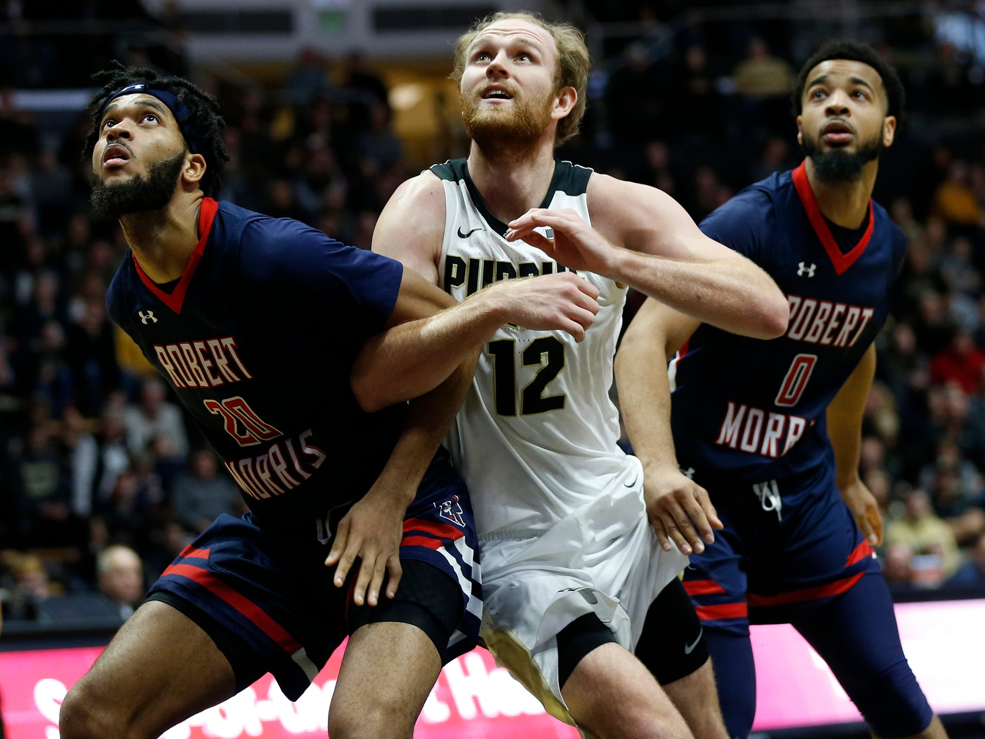 Evan Boudreaux of Purdue battles Charles Bain of Robert Morris for position Friday, November 23, 2018, at Mackey Arena. Purdue defeated Robert Morris 84-46.
