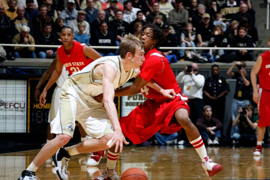 Jan 12, 2008; West Lafayette, IN, USA; Purdue Boilermakers guard (4) Robbie Hummel driving to the basket against Ohio State Buckeyes guard (4) P.J. Hill at Mackey Arena. Purdue defeated Ohio State 75-68. Mandatory Credit: Photo by Brian Spurlock-USA TODAY Sports