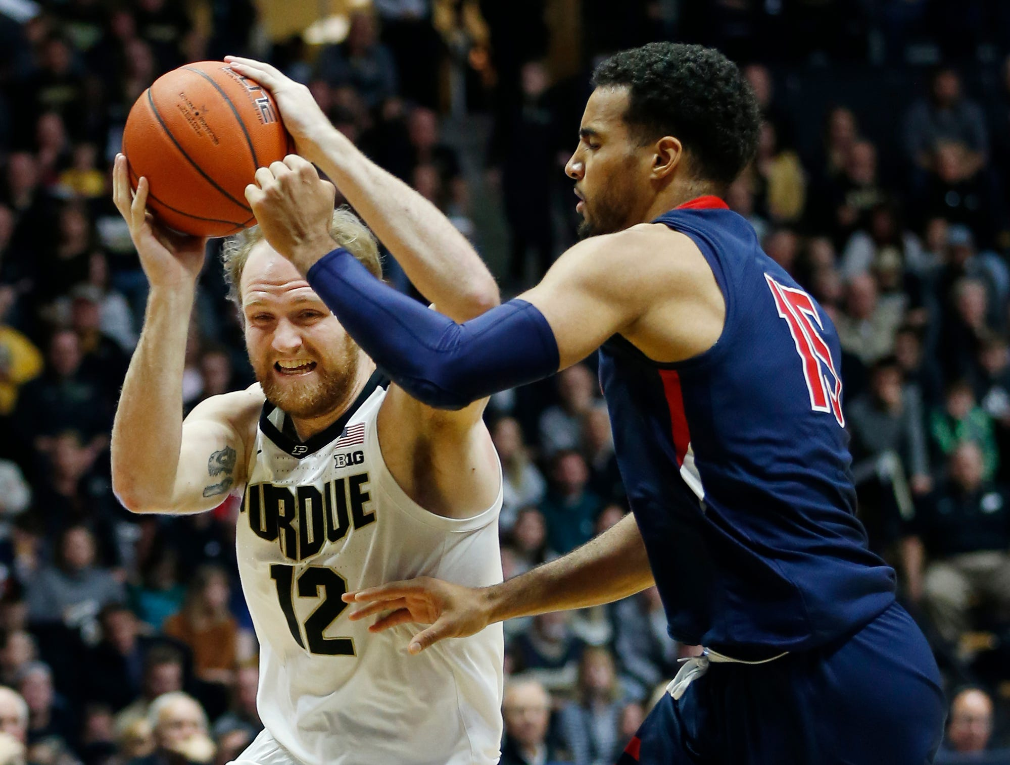 Evan Boudreaux of Purdue with a drive against Yannis Mendy of Robert Morris Friday, November 23, 2018, at Mackey Arena. Purdue defeated Robert Morris 84-46.