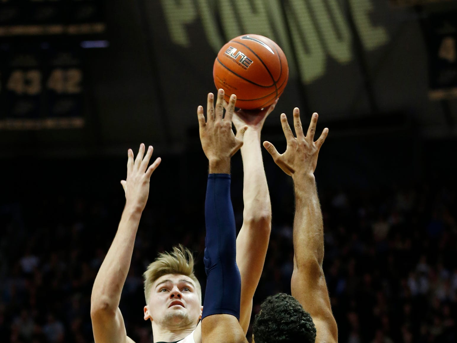 Matt Haarms of Purdue with a shot over Yannis Mendy of Robert Morris Friday, November 23, 2018, at Mackey Arena. Purdue defeated Robert Morris 84-46.