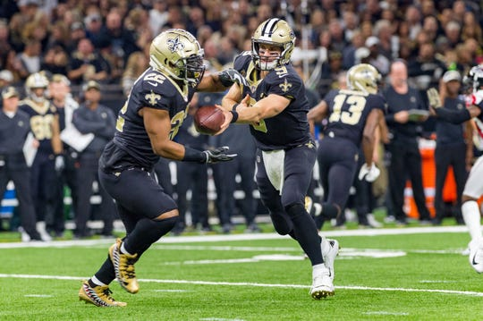 Saints quarterback Drew Brees hands off to runningback Mark Ingram during the NFL football game between the New Orleans Saints and the Atlanta Falcons in the Mecedes-Benz Superdome. Thursday, Nov. 22, 2018.
