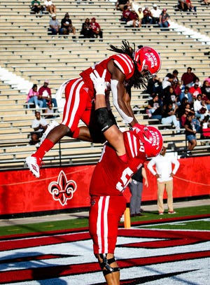 UL offensive tackle Robert Hunt lifts receiver Bam Jackson following a touchdown in the Cajuns' win over New Mexico State earlier this season.