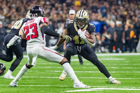 Saints runningback Alvin Kamara runs the ball during the NFL football game between the New Orleans Saints and the Atlanta Falcons in the Mecedes-Benz Superdome. Thursday, Nov. 22, 2018.