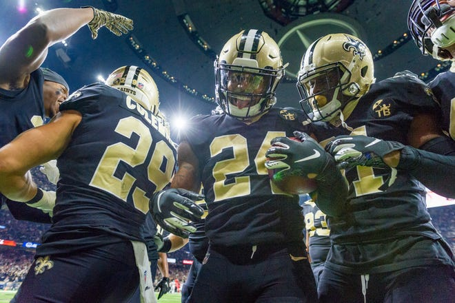 Saints defense celebrates interception in the back of the endzone during the NFL football game between the New Orleans Saints and the Atlanta Falcons in the Mecedes-Benz Superdome. Thursday, Nov. 22, 2018.